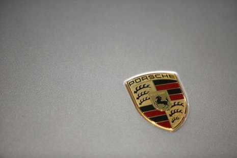 A logo is seen on a Porsche 911 Carrera 4S displayed ahead of the annual news conference at the Porsche headquarters in Stuttgart March 15,