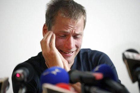 Former 50 km race walk 2008 Olympic gold medalist Alex Schwazer of Italy reacts as he holds a news conference in Bolzano August 8, 2012. REU