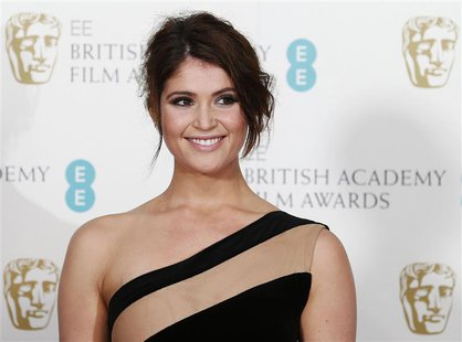 British actress Gemma Arterton poses for photographers at the British Academy of Film and Arts (BAFTA) awards ceremony at the Royal Opera Ho