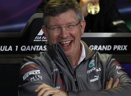 Mercedes Formula One team principal Ross Brawn laughs during a new conference following the second practice session of the Australian F1 Gra