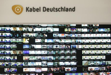 The logo of Germany's biggest cable operator, Kabel Deutschland, is pictured above a monitor wall at the Kabel Deutschland playout center in