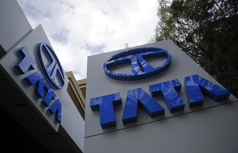 Tata Motors logos are seen at their flagship showroom in Mumbai February 14, 2013. REUTERS/Vivek Prakash