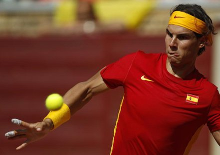 Rafael Nadal of Spain looks at the ball before returning a shot during his Davis Cup World Group semi-final against Jo-Wilfried Tsonga of Fr