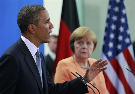 U.S. President Barack Obama speaks next to German Chancellor Angela Merkel during a news conference after their meeting at the Chancellery i