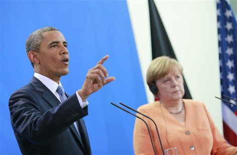 U.S. President Barack Obama speaks next to German Chancellor Angela Merkel (R) during a news conference after their meeting at the Chancelle