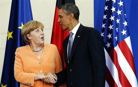 U.S. President Barack Obama and German Chancellor Angela Merkel shake hands at the end of a joint news conference at the Chancellery in Berl
