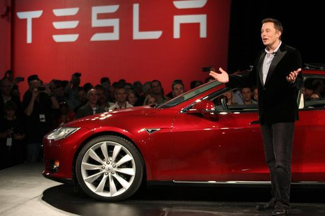 Tesla Motors CEO Elon Musk speaks next to the company's newest Model S during the Model S Beta Event held at the Tesla factory in Fremont, C