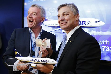 President and CEO of Boeing Commercial Airplanes Ray Conner (R) and Ryanair Chief Executive Michael O'Leary share a light hearted moment as