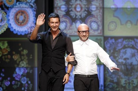 Italian designers Domenico Dolce (R) and Stefano Gabbana acknowledge the applause at the end of D&G Spring/Summer 2012 women's collection sh