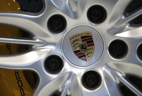 A logo is seen on a wheel of a Porsche 911 Carrera 4S ahead of the annual news conference at the Porsche headquarters in Stuttgart March 15,