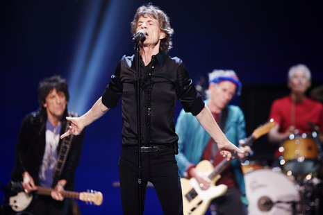 Mick Jagger (2nd L) performs with Ronnie Wood (rear L-R), Keith Richards and Charlie Watts of the Rolling Stones at a concert during the ban