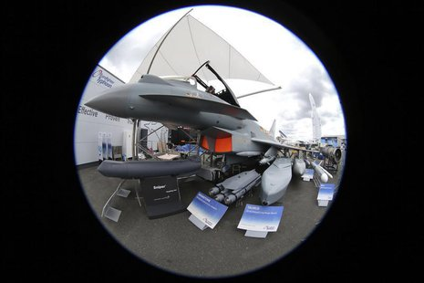 An Eurofighter Typhoon jet is seen with weapons in a static display area, two days before the opening of the 50th Paris Air Show, at the Le