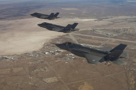 Three F-35 Joint Strike Fighters (rear to front) AF-2, AF-3 and AF-4, can be seen flying over Edwards Air Force Base in this December 10, 20