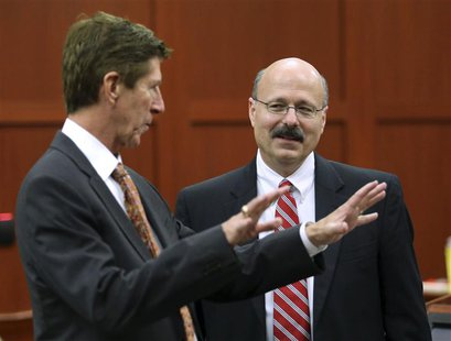 Defense Attorney Mark O'Mara (L) and prosecutor Bernie de la Rionda talk as jury selection continues in George Zimmerman's second-degree mur