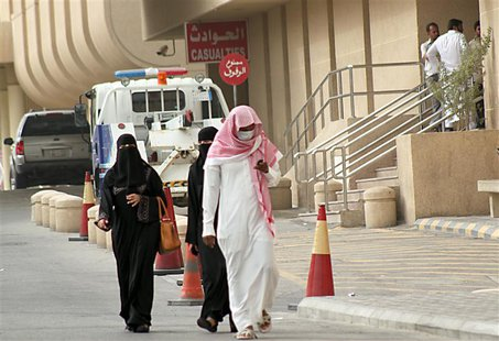A man, wearing a surgical mask as a precautionary measure against the novel coronavirus, walks near a hospital in Khobar city in Dammam May