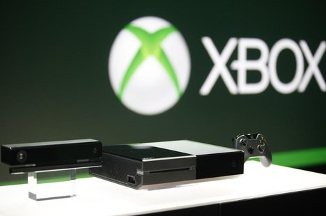 Xbox One (C) with the Kinect motions sensor (L) and the controller is pictured during a press event unveiling Microsoft's new Xbox in Redmon