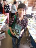 Peter Vang, fourth grade, after selecting his summer reading books at Washington School.