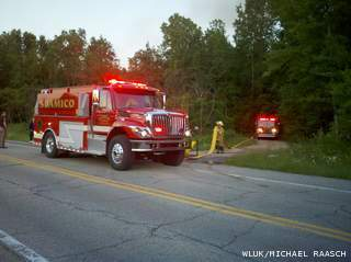 Fire crews respond to a house fire in Suamico on Wednesday June 19, 2013. (courtesy of FOX 11).