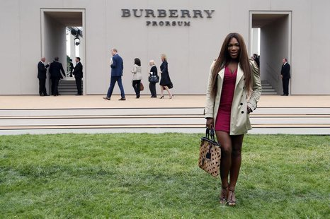 U.S. tennis player Serena Williams arrives for the Burberry Spring/Summer 2014 men's collection fashion show in London June 18, 2013. REUTER