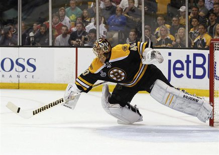 Boston Bruins goalie Tuukka Rask makes a save against the Chicago Blackhawks during the first period in Game 4 of their NHL Stanley Cup Fina