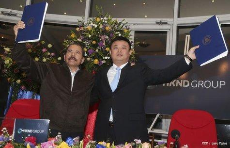 Nicaragua's President Daniel Ortega (L) and Wang Jing, chairman of the Hong Kong international company Nicaragua Canal Development Investmen