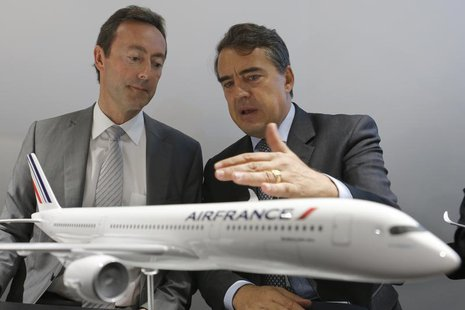 Airbus' Chairman and CEO Fabrice Bregier (L) talks with Air-France KLM Chairman and CEO Alexandre de Juniac during a signing ceremony at the