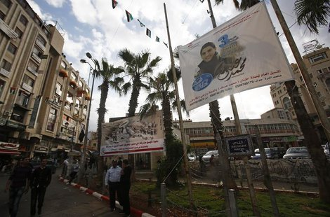 A banner depicting Mohammed Assaf, a contestant in the TV talent show 'Arab Idol', hangs from poles in the West Bank city of Ramallah May 13