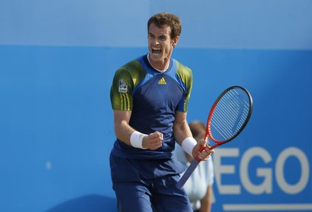 Britain's Andy Murray reacts after defeating Croatia's Marin Cilic during their men's singles final tennis match at the Queen's Club Champio