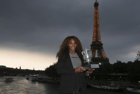 Serena Williams of the U.S. poses with her trophy near the Eiffel Tower in Paris after winning against Maria Sharapova of Russia in the wome