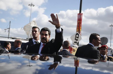 Venezuela's President Nicolas Maduro greets supporters after a meeting with Portuguese and Venezuelan businessmen in Lisbon June 18, 2013. R