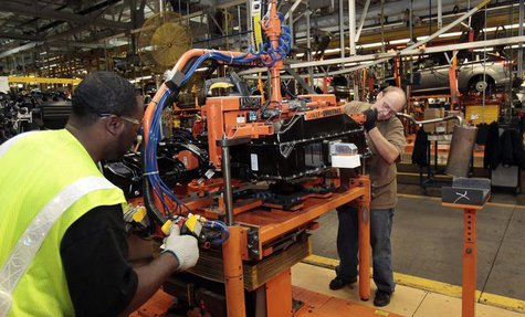 Ford Assembly workers install a battery onto the chassis of a Ford Focus Electric vehicle at the Michigan Assembly Plant in Wayne, Michigan