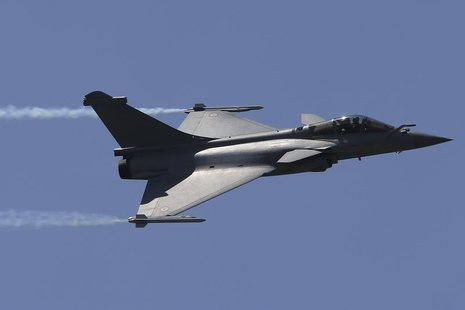 A Dassault Rafale fighter aircraft takes part in a flying display during the opening of the 50th Paris Air Show at Le Bourget airport near P