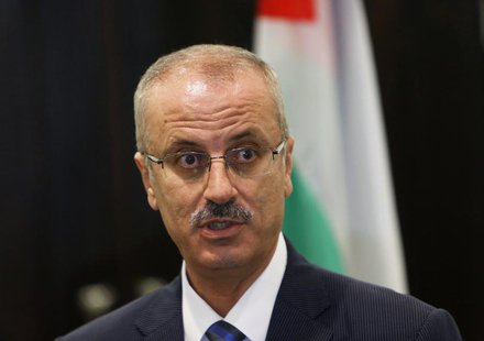 Palestinian Prime Minister Rami Hamdallah speaks during a joint news conference with European Union foreign policy chief Catherine Ashton (n