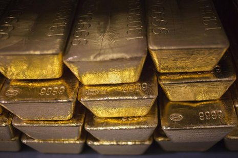 Twenty four karat gold bars are seen at the United States West Point Mint facility in West Point, New York June 5, 2013. REUTERS/Shannon Sta