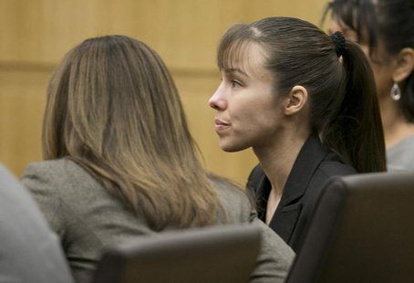 Jodi Arias listens as the verdict for sentencing is read for her first degree murder conviction at Maricopa County Superior Court in Phoenix
