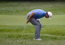Tiger Woods holding elbow after a shot at the US Open.