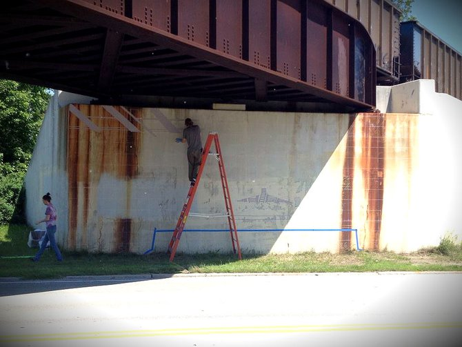 Artist Gabriel Specter painting for The Sheboygan Project