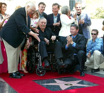 "James Doohan, (C) who played ""Scotty"" in the 1960's TV series 'Star Trek,' receives his star on the famous Hollywood Walk of Fame as fans, f"