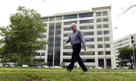 A man walks pass the Booz Allen Hamilton Holding Corp building in McLean, Virginia June 11, 2013. REUTERS/Kevin Lamarque
