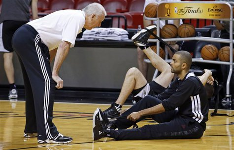 San Antonio Spurs Head Coach Gregg Popovich (L) talks with guard Tony Parker during a team practice ahead of Game 7 of the NBA Finals basket