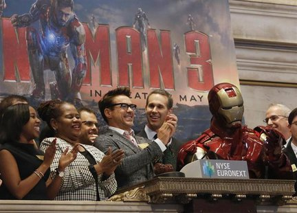Actor Robert Downey Jr. (C) rings the opening bell at the New York Stock Exchange to promote his new movie 'Iron Man 3' April 30, 2013. REUT