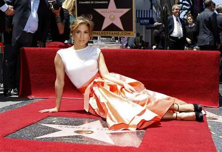 Singer and actress Jennifer Lopez poses on her star after it was unveiled on the Walk of Fame in Hollywood, California June 20, 2013. REUTER