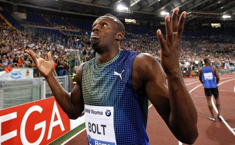 Usain Bolt of Jamaica reacts at the end of the 100m event at the Golden Gala IAAF Diamond League at the Olympic stadium in Rome June 6, 2013
