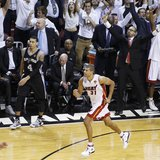 Miami Heat's Shane Battier (31) reacts after hitting a three point basket over San Antonio Spurs' Danny Green during the fourth quarter in G
