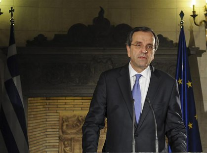 Greece's Prime Minister Antonis Samaras addresses the nation from his office in Athens June 21, 2013. REUTERS/Greek Prime Minister's Office/