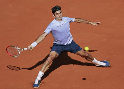 Roger Federer of Switzerland hits a return to Jo-Wilfried Tsonga of France during their men's singles quarter-final match at the French Open