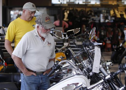 Customers look at the showroom inventory at Harley-Davidson of Frederick in Frederick Maryland in this October 23, 2012 file photo. Unless t