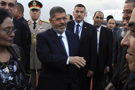 Egypt's President Mohamed Mursi (C) arrives at Bole International airport for the 21st Ordinary Session of the African Union (AU) in Addis A