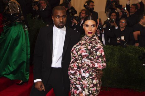Singer Kanye West and reality television actress Kim Kardashian arrive at the Metropolitan Museum of Art Costume Institute Benefit celebrati