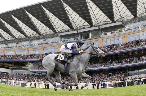 Richard Hughes rides Sky Lantern to victory in the Coronation Stakes during the fourth day of the Royal Ascot horse racing festival at Ascot